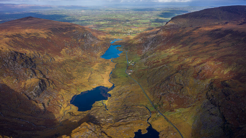 View of the Gap of Dunloe from the air. You can see either side of the mountains and 3 lakes in the middle